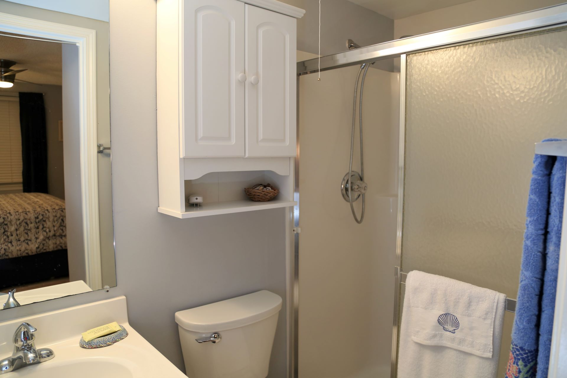 The en-suite master bathroom includes a stall shower and bat