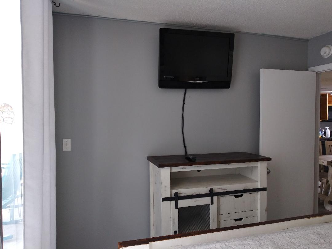 The master bedroom with TV & dresser for storage.