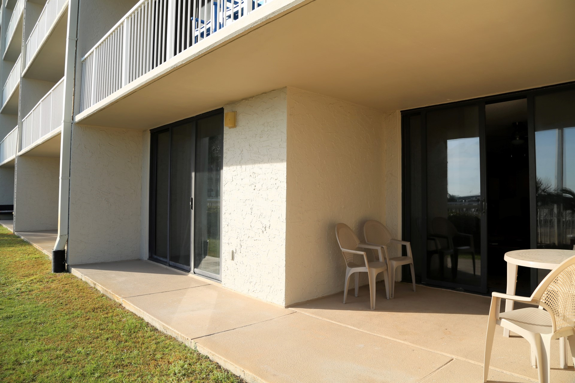 Your ground floor, spacious patio with outdoor table and cha