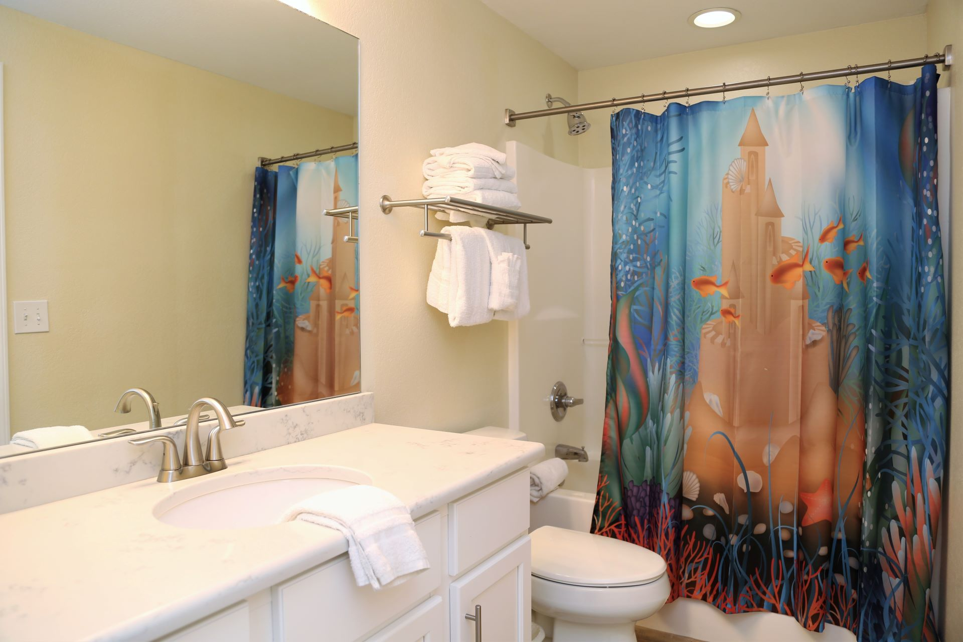 The second bathroom with shower/tub combo is accessible from