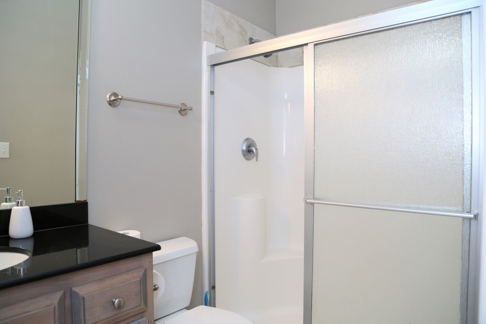 The en-suite bathroom with shower (no tub) located in the Qu