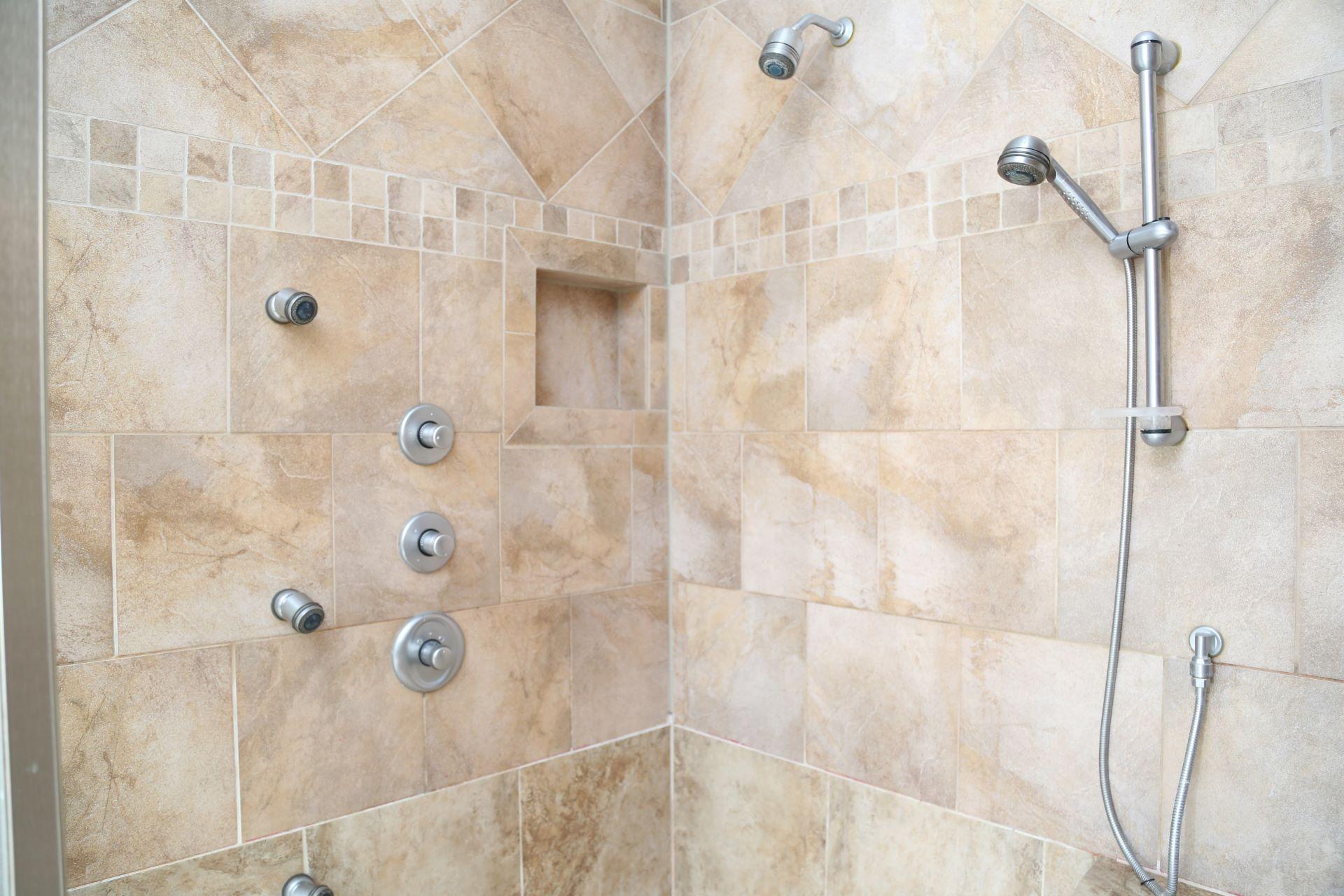 Beautiful, tiled steam shower.
