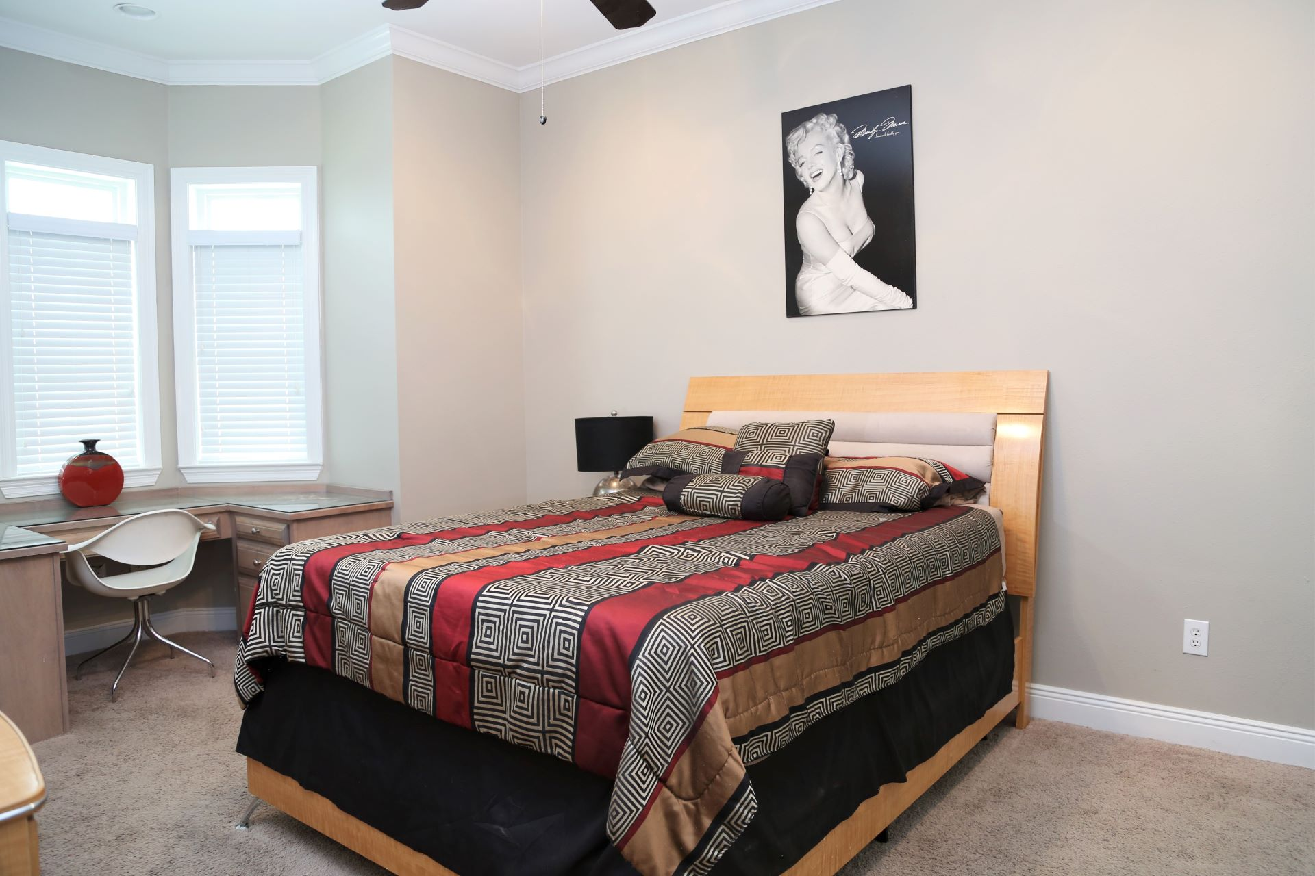 The first bedroom includes a Queen-sized bed.