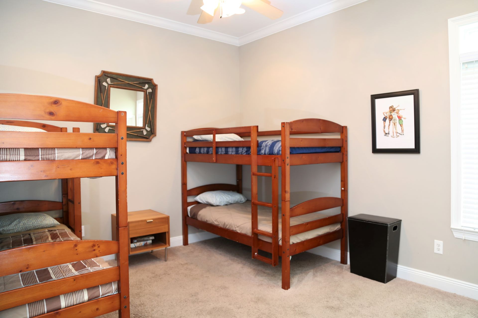 The second bedroom includes two sets of twin bunk beds.