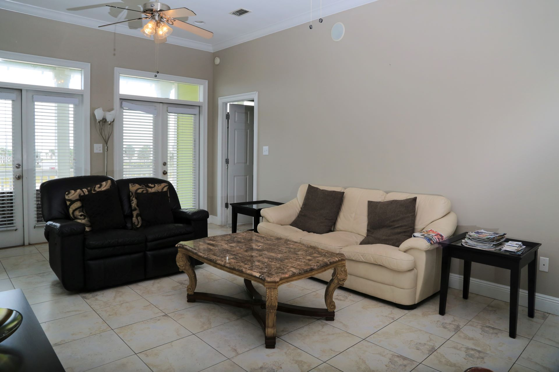Spacious living room with sleeper sofa.
