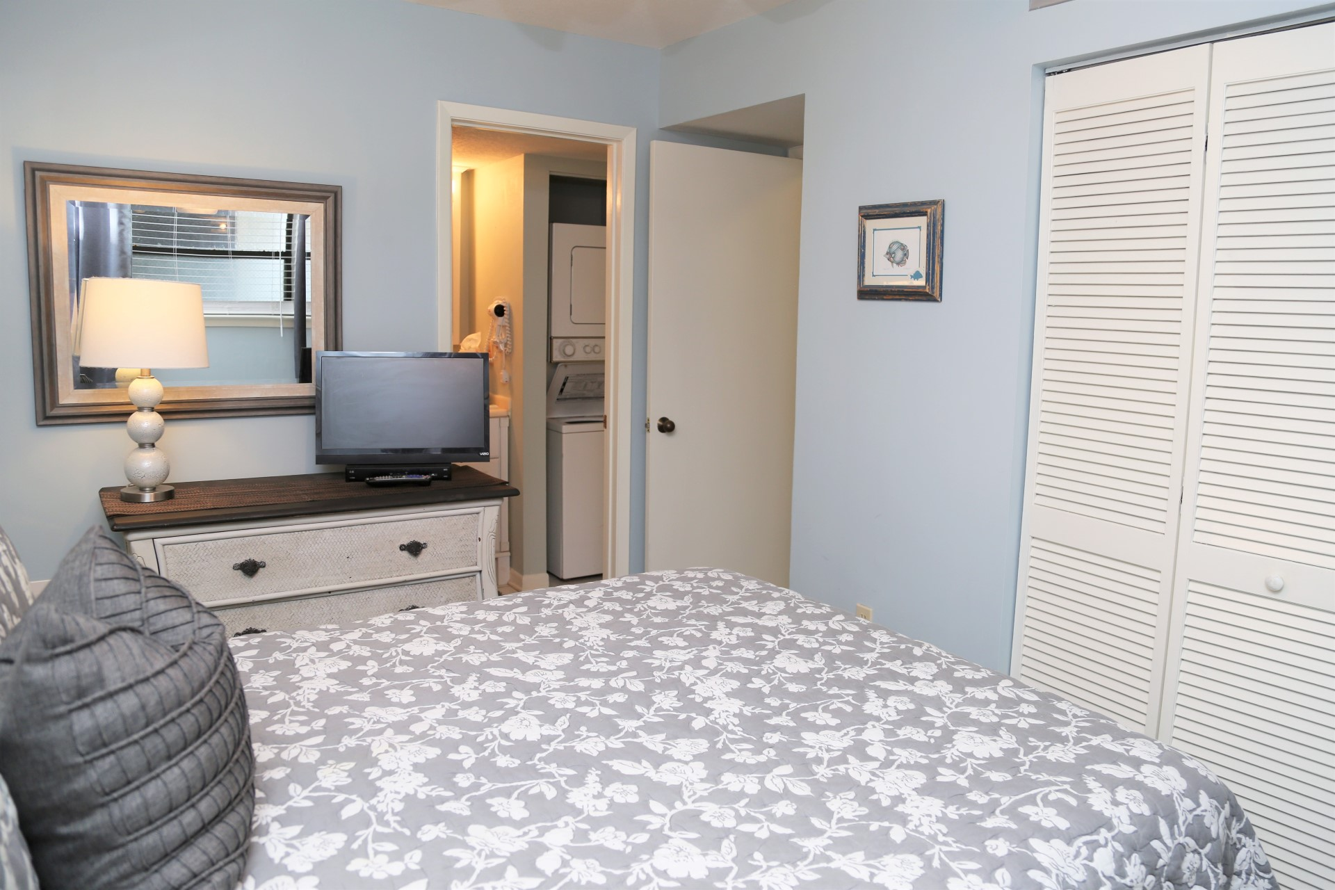 The master bedroom with dresser and closet for storage.