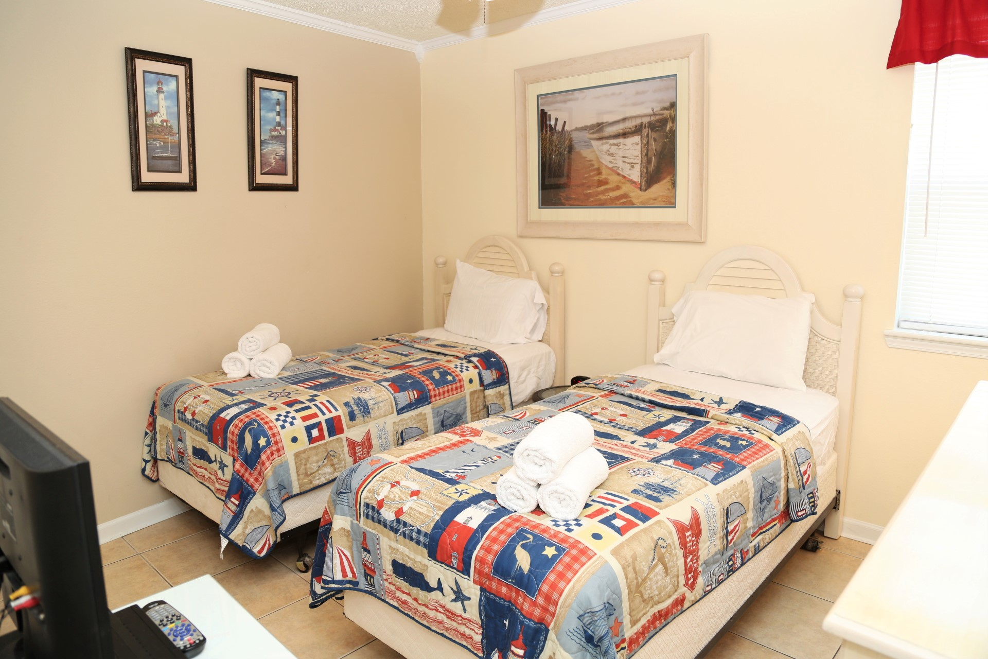 The second bedroom includes 2 twin-size beds.