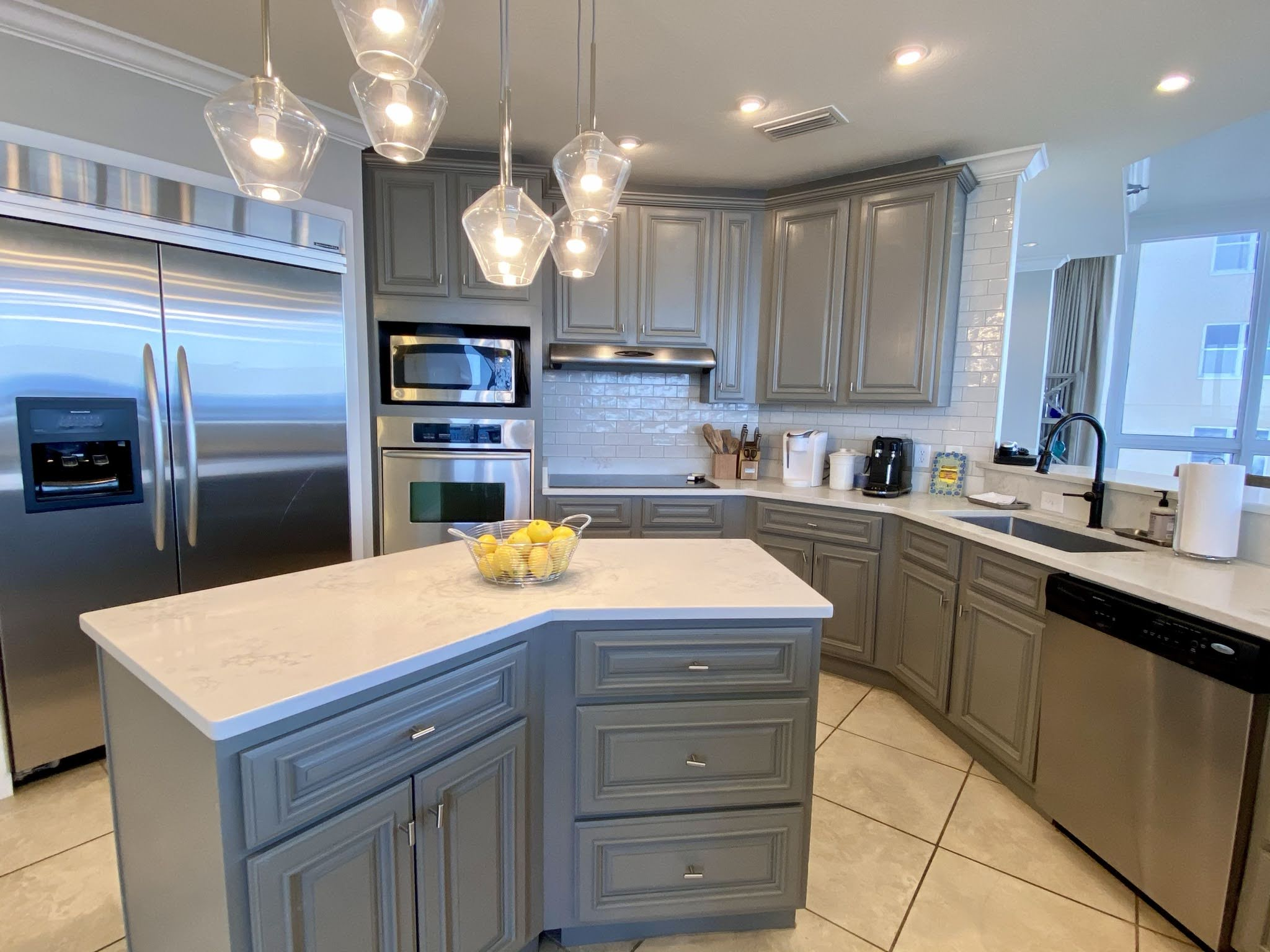 The fully equipped kitchen includes quality, stainless steel