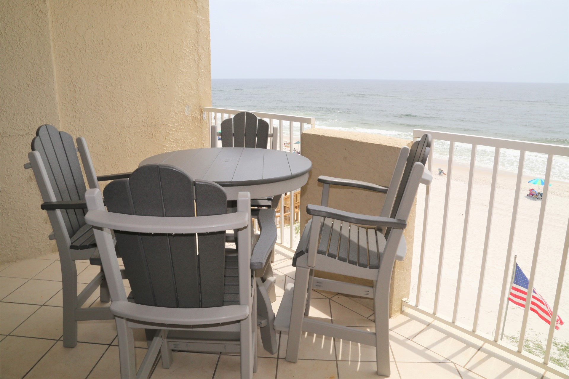 Ease onto your private balcony, which includes table
