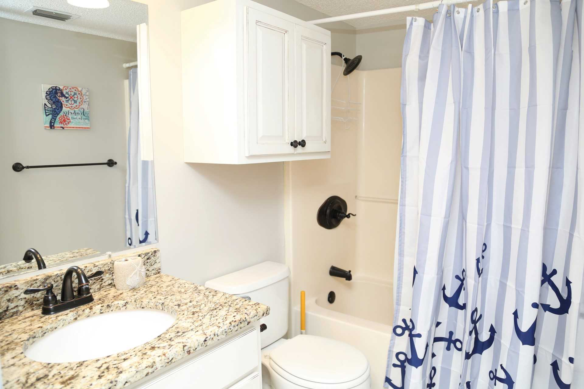 The second bathroom with a tub/shower combo.