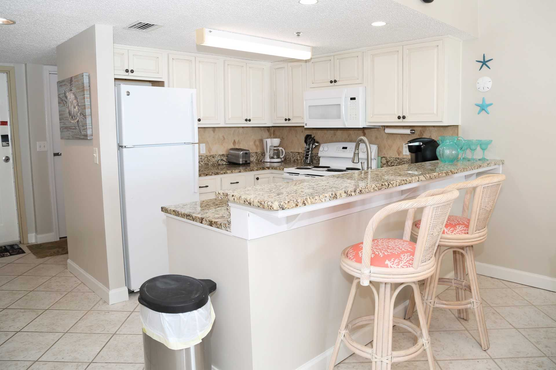 The kitchen is fully equipped to whip up home-cooked meals.