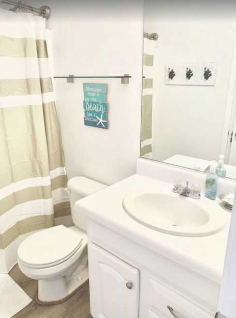 The second bathroom with shower/tub combo.