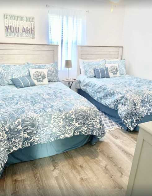 The second bedroom includes two Queen-sized beds.