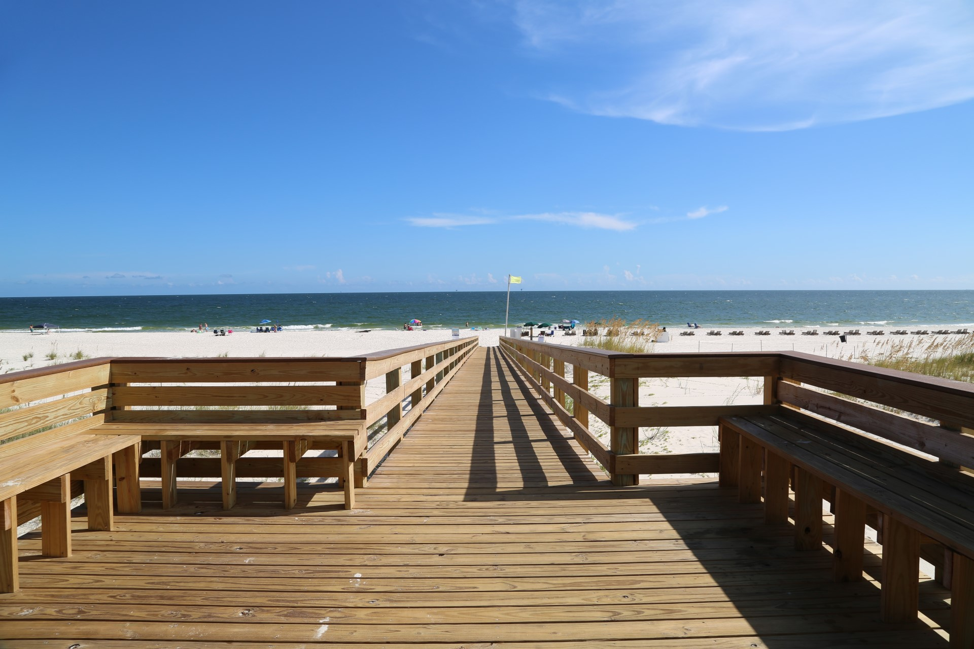 Boardwalk benches perfect for sunset views at Gulf Shores Pl