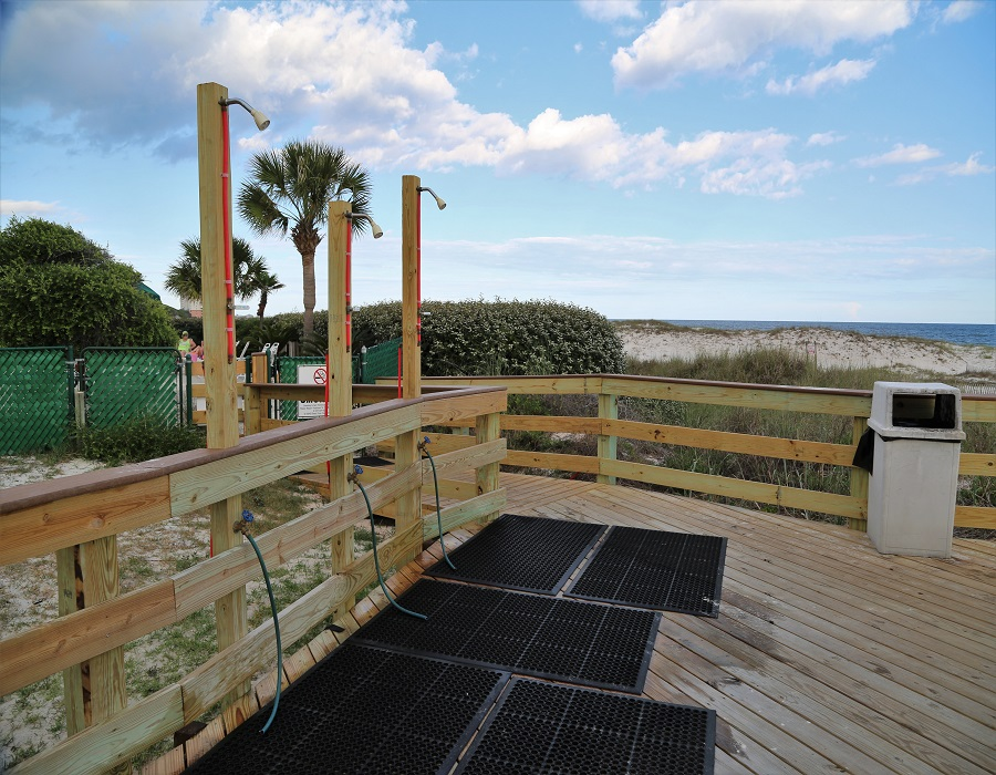 Outdoor showers on boardwalk
