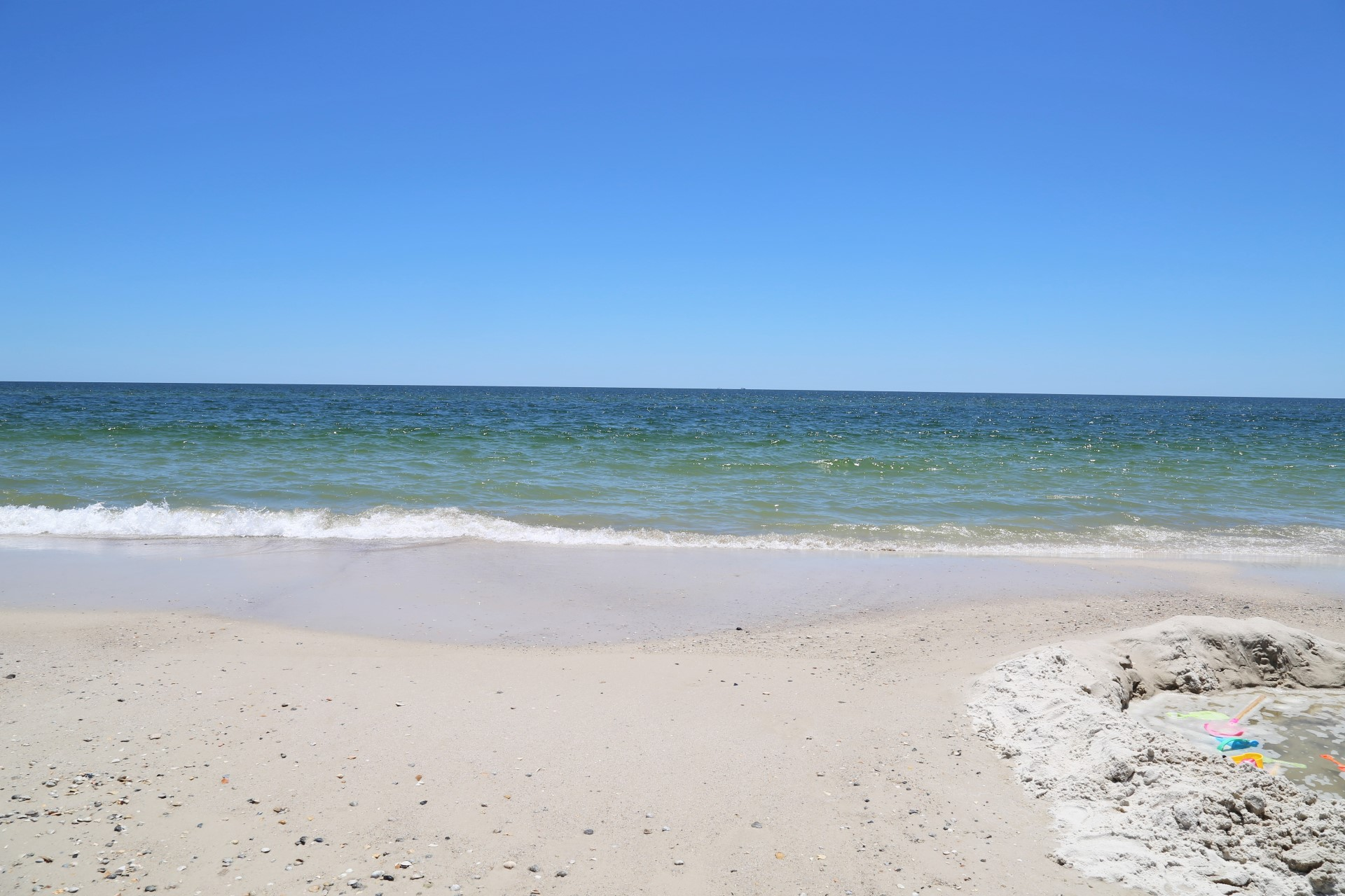 Build a sandcastle next to the sparkling emerald gulf water!