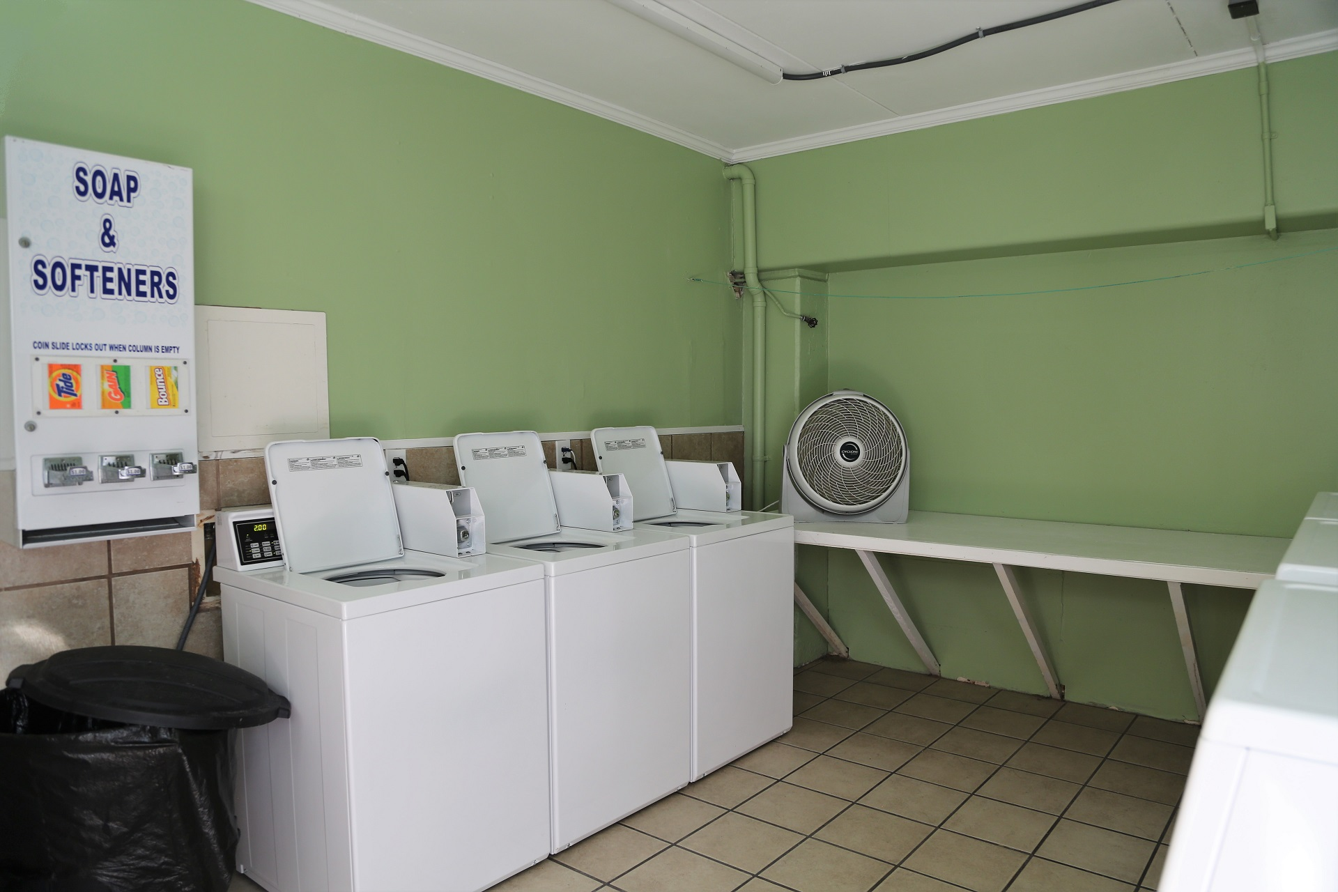 Convenient laundry room located by the pool deck